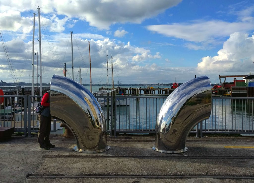 Spending One Beautiful Day in Auckland, New Zealand - Heritage Landing has interesting artwork/sculptures. Sticking our heads in a large size pipe