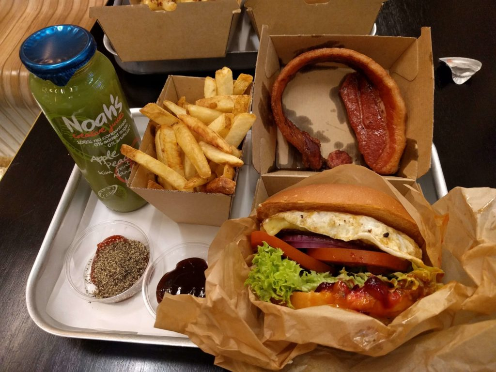 Meal at Sydney Airport's Benny Burger with a burger, fries, and juice