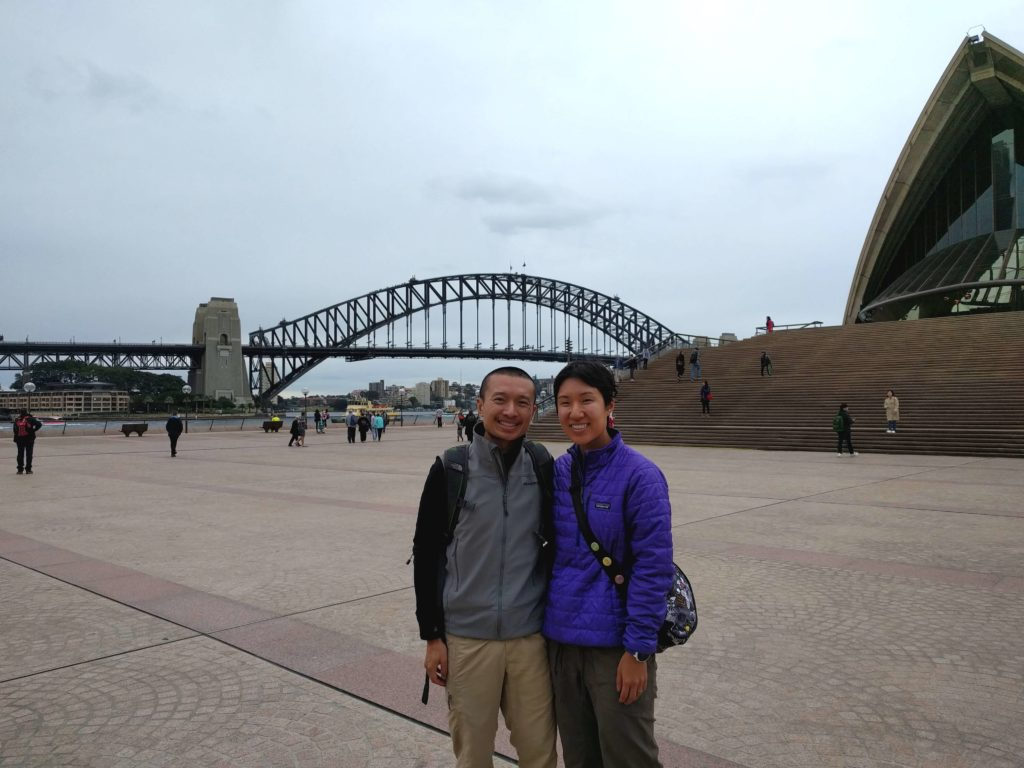 At the Sydney Opera House with the Sydney Harbour Bridge in the background.