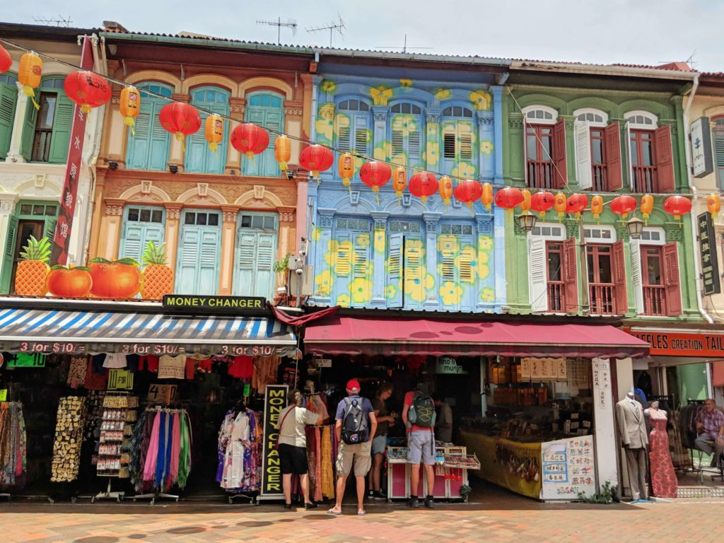 During your Singapore layover, stop by Chinatown to go shopping, see the colorful buildings, and eat street food.