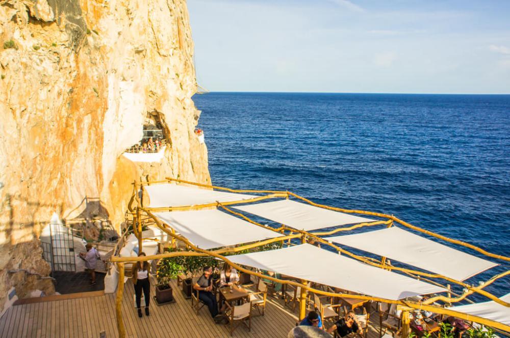 Caves Around The World in Europe: Cova d'en Xoroi Bar Cave in Menorca, Spain