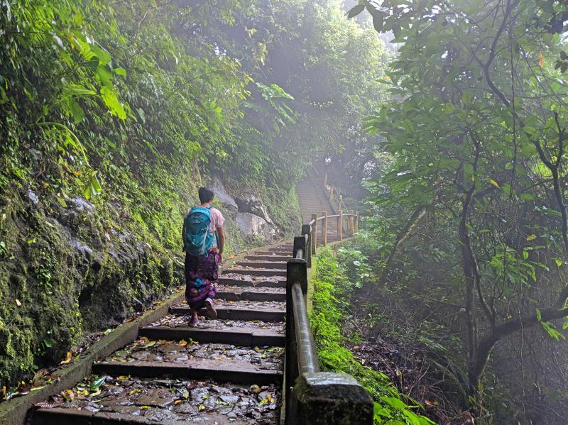 Jackie Szeto, Life Of Doing, walks up the steps of Pura Lempuyang Temple's Pura Lempuyang Luhur in Bali