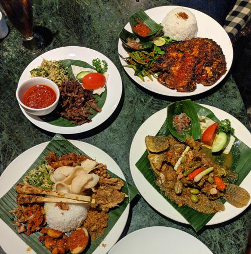 Bebek Tepi Sawah Restaurant with seafood, nasi campur, and boneless duck in Ubud, Bali, Indonesia