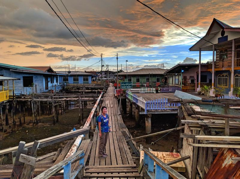 Jackie Szeto, Life Of Doing, is on a brunei layover and sees the sunset at Kampong Ayer, Water Village