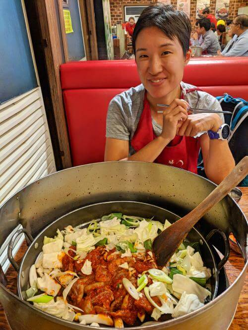 Myeongdong, Seoul, South Korea - Yoognae with chicken and octopus stir fry with vegetables