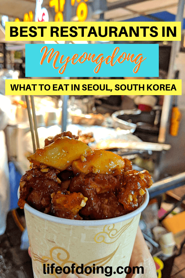Eating street food as a part of best restaurants in Myeongdong, Seoul, South Korea