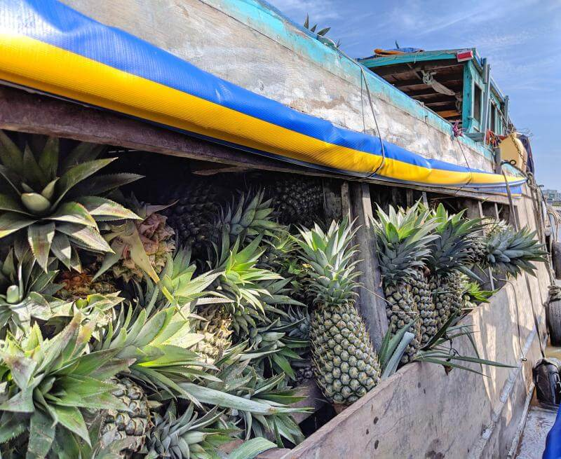 Can Tho, Vietnam: Boat full of pineapples at Cai Rang Floating Market