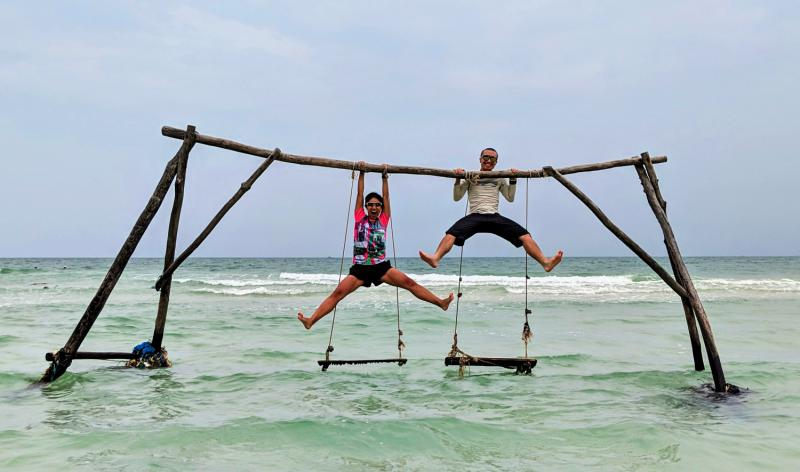 Hanging off of Swings at Sao Beach, Phu Quoc, Vietnam