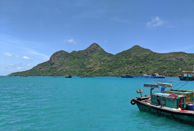 The turquoise water is mesmerizing when you visit Con Dao, Vietnam. You'll often find fishermen boats around the island catching fresh seafood of the day. Don't forget to eat seafood as one of the top things to do in Con Dao!