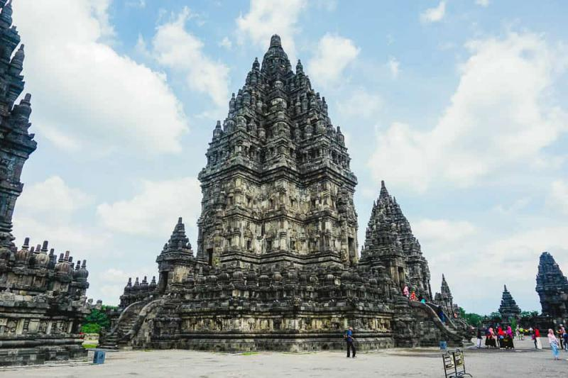 Prambanan Temple is a large Hindu temple complex in Java, Indonesia. It's recommended to walk around to explore hundreds of temples in the area.