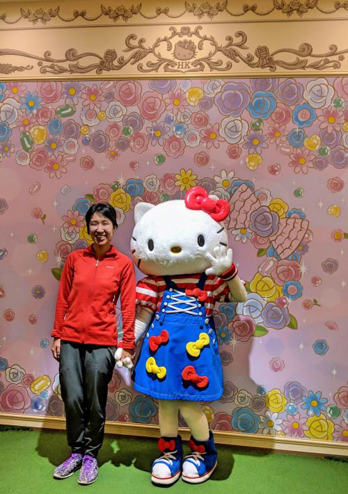 Jackie Szeto, from Life Of Doing, is at Sanrio Puroland's Lady Kitty House, you can meet Hello Kitty herself with a photo opportunity. During my visit, Hello Kitty wore a simple blue dress with her bows on it and a red and white striped shirt.