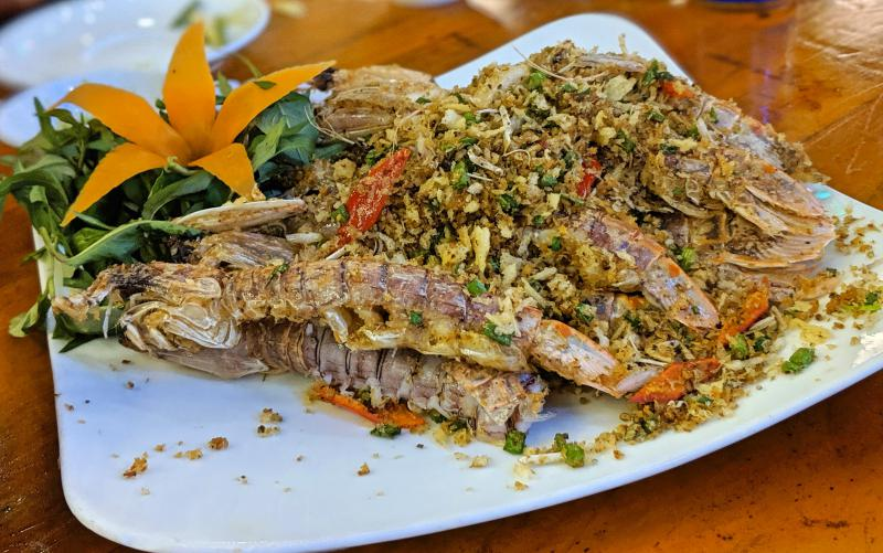 Fresh seafood is a must eat while you're in Quy Nhon, Vietnam. Definitely try the snails and clams and the mantis shrimp which is shown here. The mantis shrimp is topped with lemongrass and garlic.