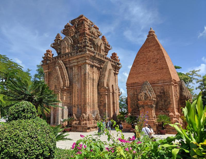 Two Cham Towers at the Po Nagar Towers in Nha Trang. The towers are made out of red bricks and have a triangular roof.
