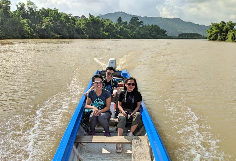We're riding a boat along the Dong Nai River and Justin is driving it