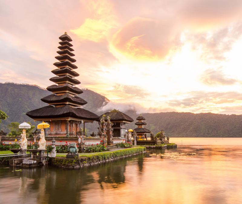 Pink and orange skies with the views of Pura Ulun Danu Beratan and Lake Beratan in North Bali.