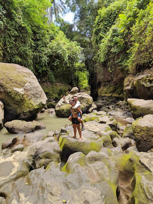 We're on one of the more drier spots standing on a rock at Hidden Canyon in Bali.