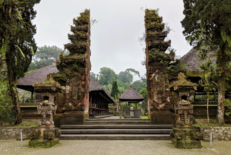 Pura Luhur Batakau's entrance way and the temple ground has moss covering on everything which provides a rustic look.