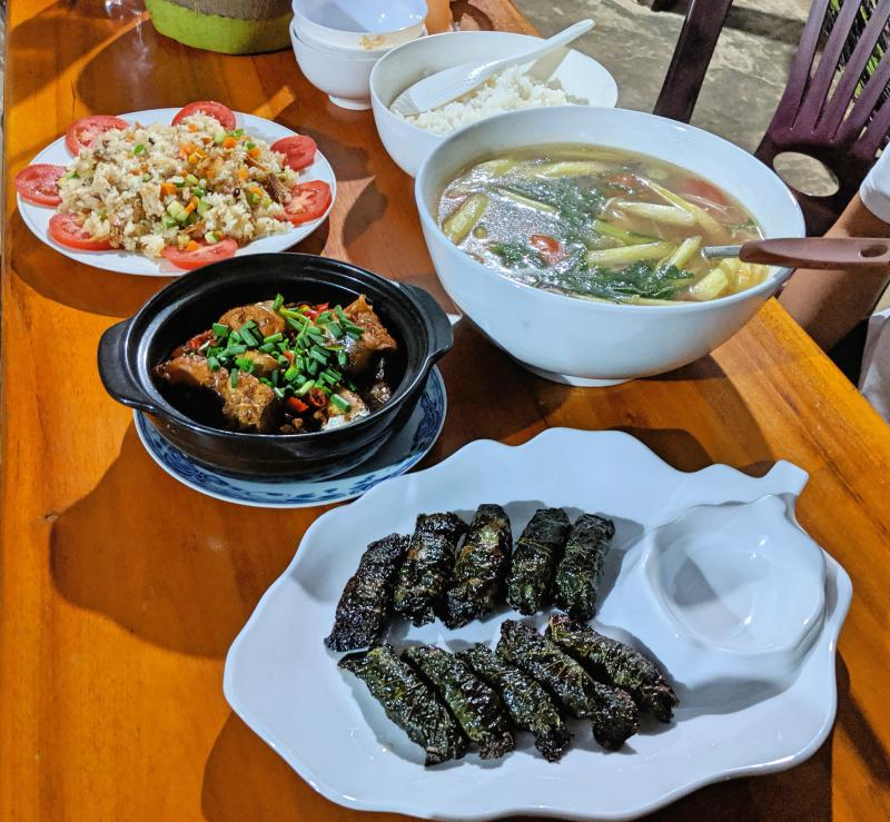 Dinner at Quán Hạnh nearby Cat Tien National Park. Meal included sweet and soup catfish soup, caramelized catfish, fried rice with salted fish, and beef wrapped in leaves.