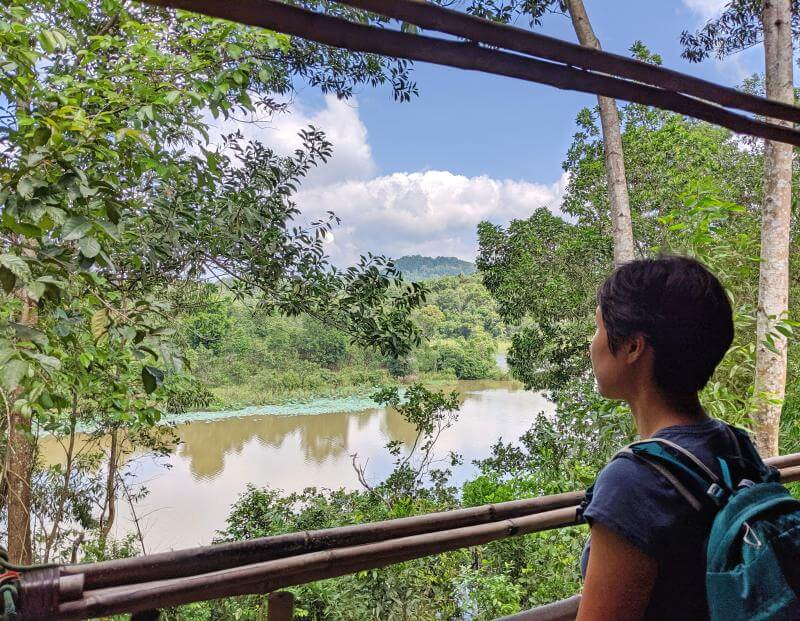 Enjoying the beautiful views from the Ta Lai Longhouse with the trees and the calm river.