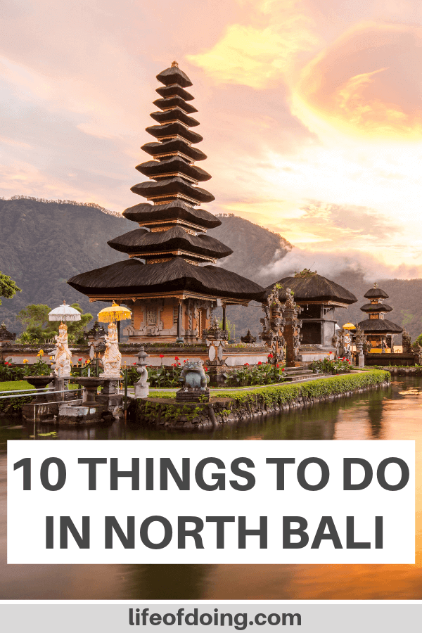 Our post highlights the top things to do in North Bali, Indonesia. This photo is of the Pura Ulun Danu Beratan with the pink and orange skies.