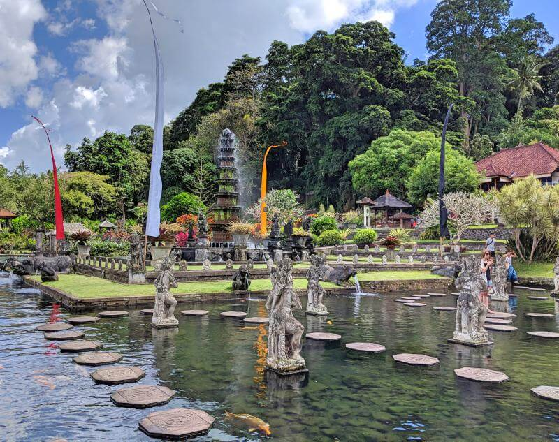 Tirta Gangga Water Palace has beautiful guardian statues and a maze walking path around the pool.