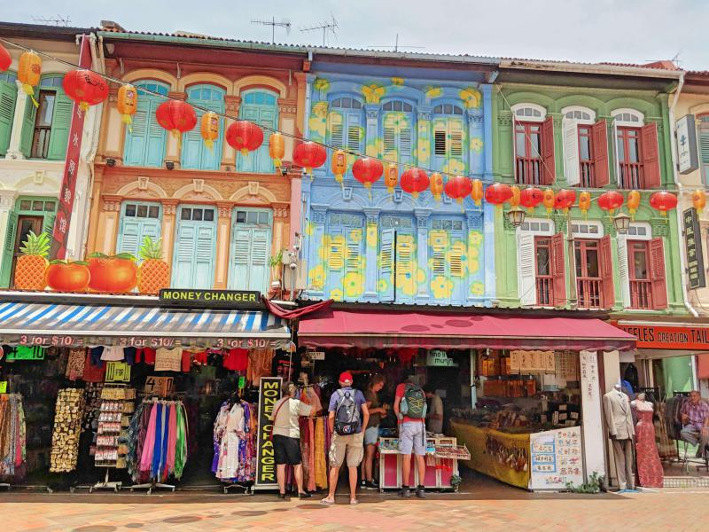 Explore the colorful houses in Singapore's Chinatown with Chinese architecture and also go shopping.