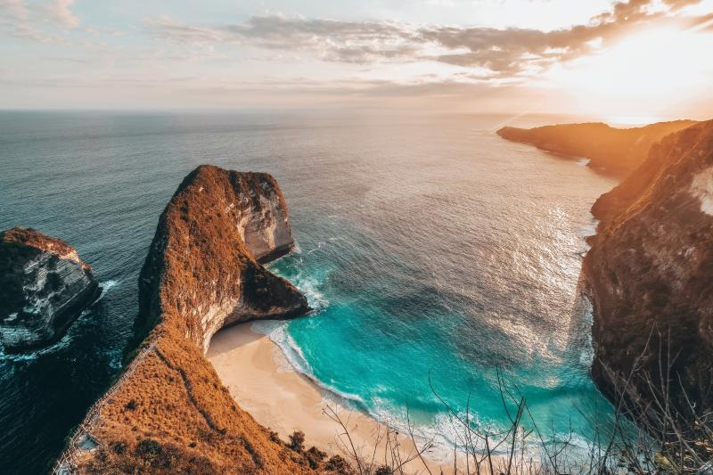 Nusa Penida's Kelingking Beach at sunset.