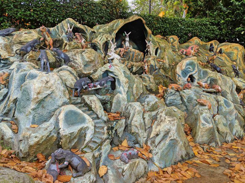 Artwork of mice and rabbits killing each other at Haw Par Villa in Singapore.