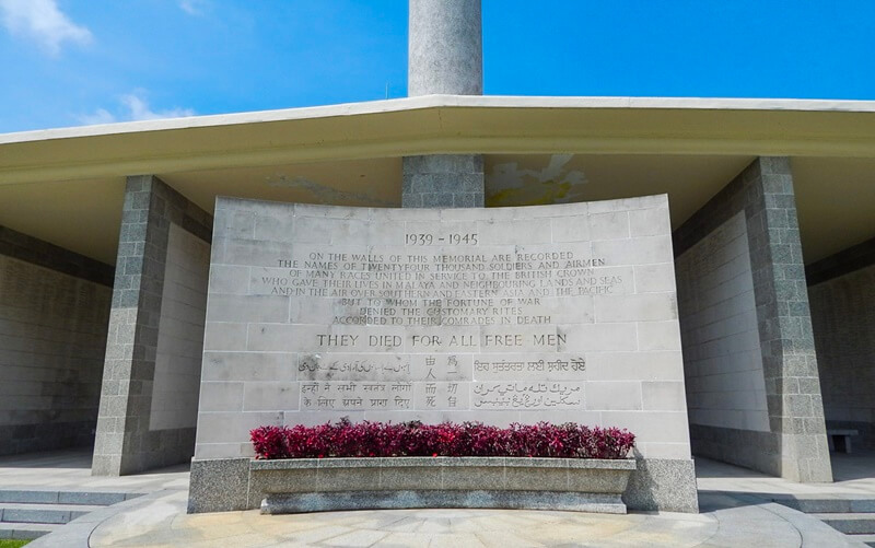 A stone memorial that states over 24,000 soldiers and airmen gave their lives and are honored at the Kranji War Cemetery in Singapore.