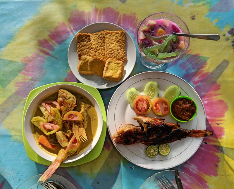 Our dinner at WR Makan RESTU off of Nusa Penida's Toya Pakeh beach. Meal has grilled fish, fish stew, fried tofu and tempeh, and dessert.