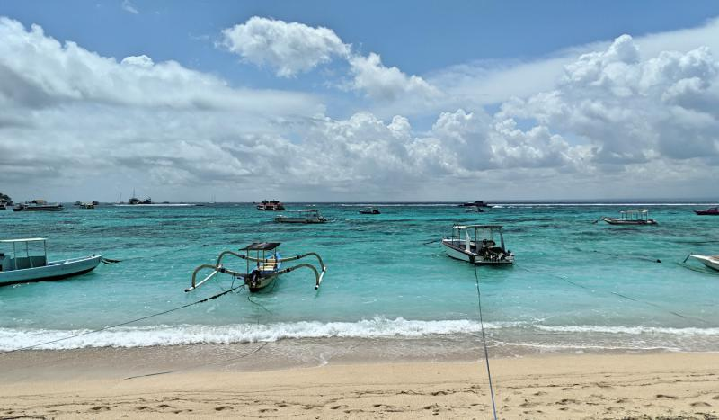 Boats floating in the water along one of the beaches in Nusa Lembongan, Indonesia