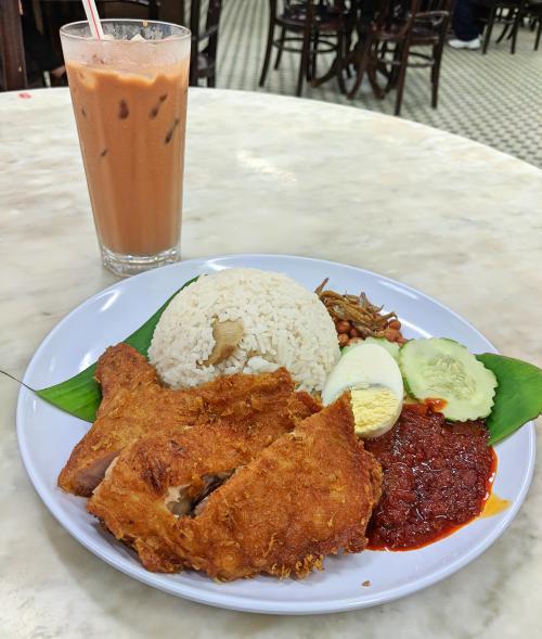 Nasi lemak and teh tarik at Capitol Cafe, Kuala Lumpur. It's a great place to eat in Kuala Lumpur.