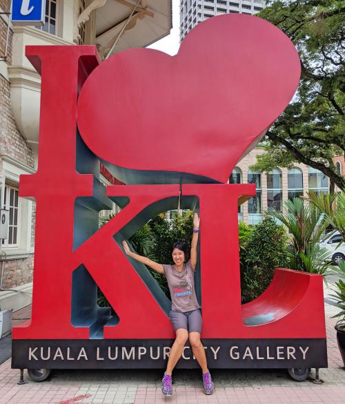 Jackie Szeto, Life Of Doing, poses with the I Heart KL sign at the KL City Gallery