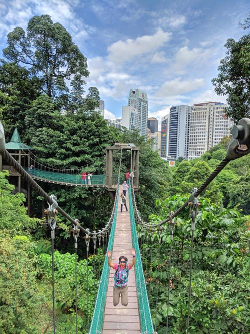 Jackie Szeto, from Life Of Doing, jumps on the suspension bridge at KL Forest Eco Park. It is a fun place to visit the canopy suspension bridges.