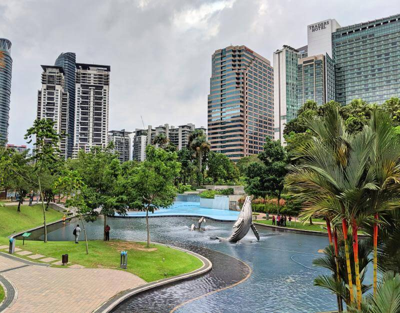 View of the KLCC Park with the humpback whale statue in the lake