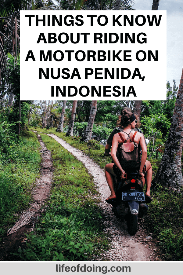 A couple on a motorbike driving through Nusa Penida, Indonesia. Post contains things to know about driving a motorbike on Nusa Penida.
