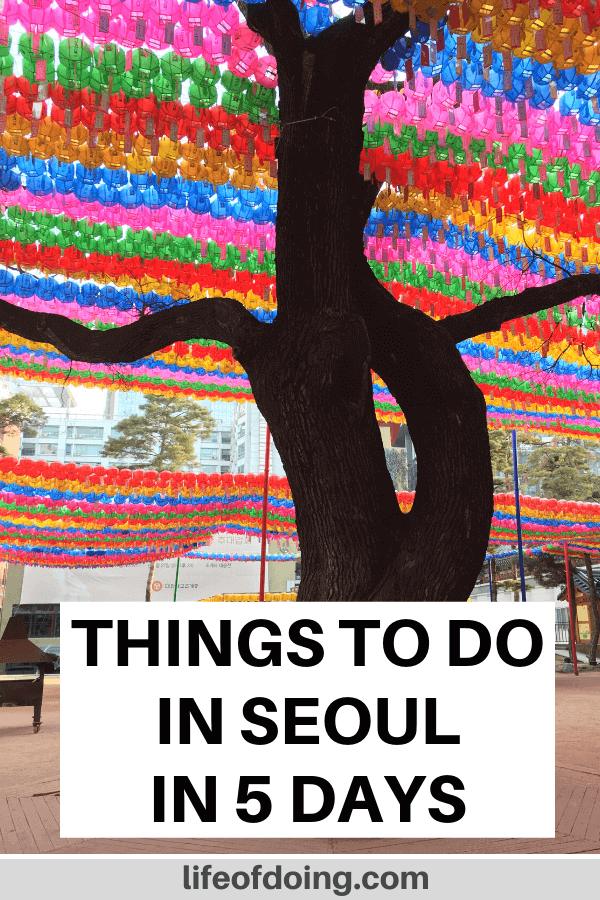 Top things to do in Seoul, South Korea in five days. Photo is of the Jogyesa Temple with the colorful streamers.