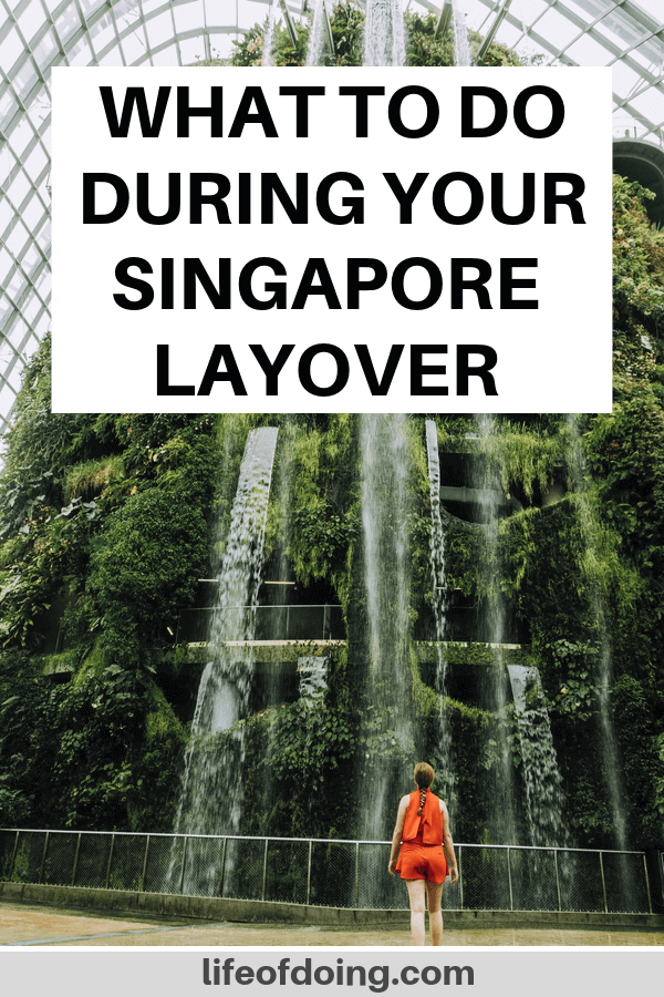 What to do in Singapore during a layover. Photo is of the waterfall inside the Gardens by the Bay Cloud Forest.