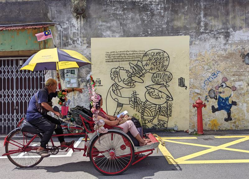 Explore Penang's George Town on a cyclo. Check out the street art during your two days in Penang.