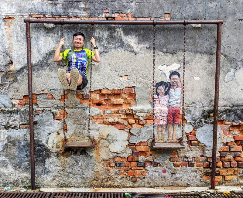 Explore Penang's street art and check out the famous children on swing artwork. Feel free to sit or hang on the swing. This is a great place to explore during your two days in Penang.
