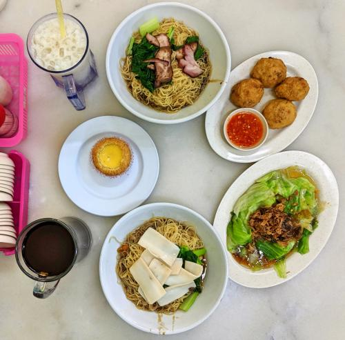 Our meal at Hong Kee Wan Thun Mee in Penang's George Town. We had wanton noodles with bbq pork, noodles with abalone, vegetables, egg tart, and tofu fishcake.