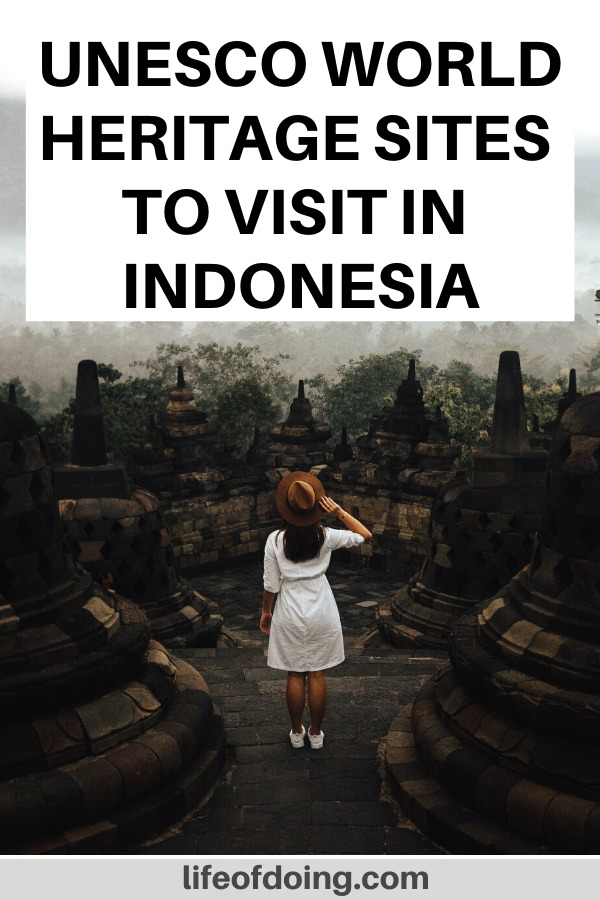 Top 9 UNESCO World Heritage sites to visit in Indonesia. Photo is of a women wearing a white dress standing in the middle of the Borobudur Temple.