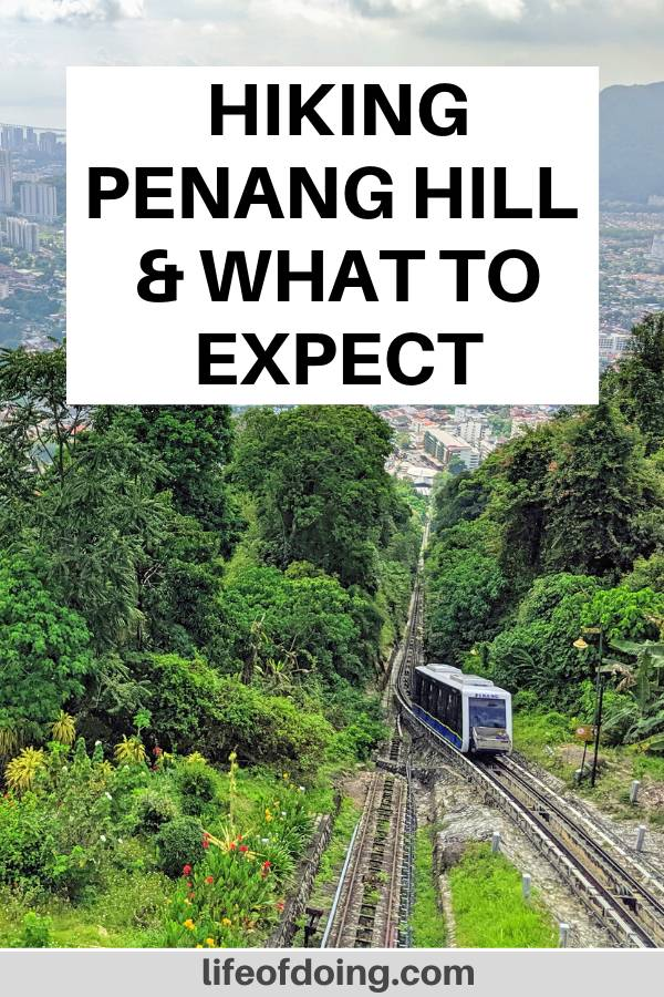We're hiking along the Penang Hill Heritage Trail. At the first station, you get a view of the Penang Hill and the city. Plus, you may see a cable car pass by.