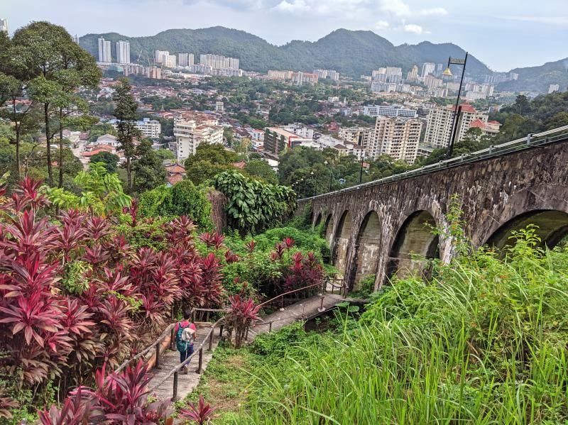 Descending down Penang Hill along the Heritage Trail stairways. You'll get stunning views of the cable car bridge and the Penang city.