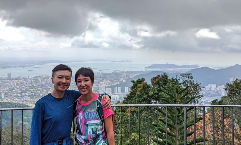 Photo of Jackie and Justin at the peak of Penang Hill and overlooking the Penang city.