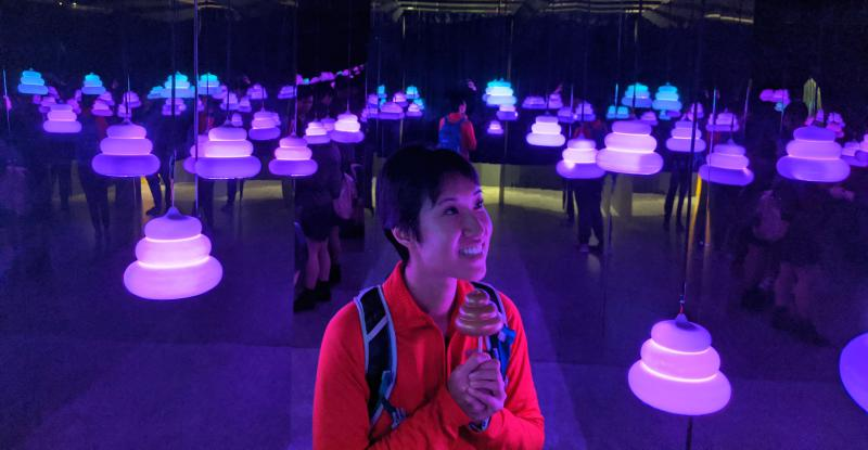 Jackie Szeto from Life Of Doing holds her unko toy as she exits Tokyo's Unko Museum with the glowing poop lights.