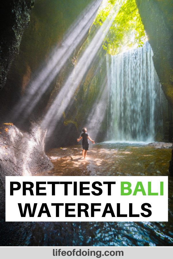 This post highlights the best 13 waterfalls in Bali to experience. One of the waterfalls is Tukad Cepung Waterfall with the sun beaming into the cave with the waterfall.
