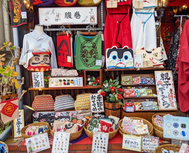 One of the best things to do in Kamakura, Japan is to go shopping along Komachi-dori street. You'll find adorable souvenirs such as clutches, purses, t-shirts, and more.