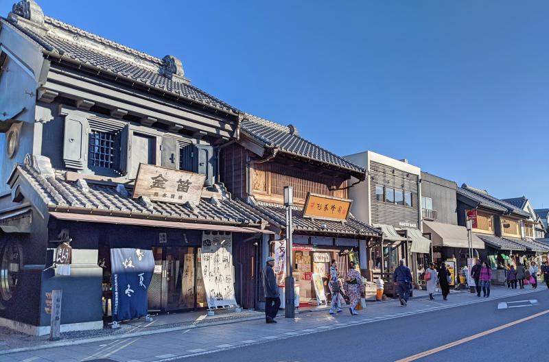 Shopping along the Kurazukuri Warehouse District in Kawagoe, Japan. It's a great way to spend the day in Kawagoe and view the traditional looking houses.