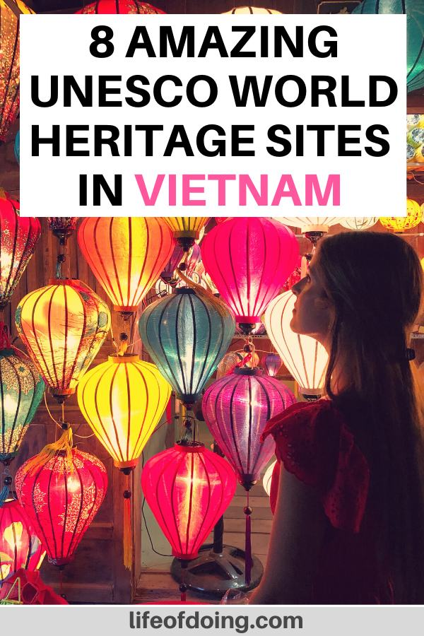 A woman in a dress stands in front of the lanterns in Hoi An, one of the UNESCO World Heritage sites in Vietnam. This post highlights the 8 UNESCO World Heritage sites to visit in Vietnam.